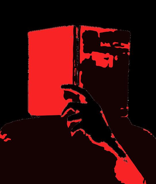 赤い本を読む人
